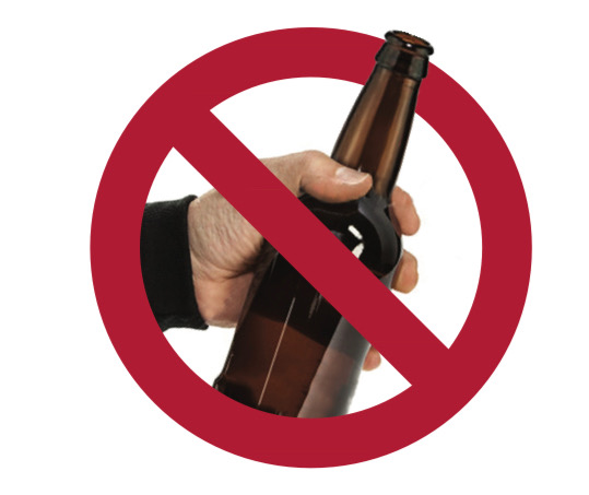 Image of a hand holding alcohol bottle with a red crossed out circle in front of it.