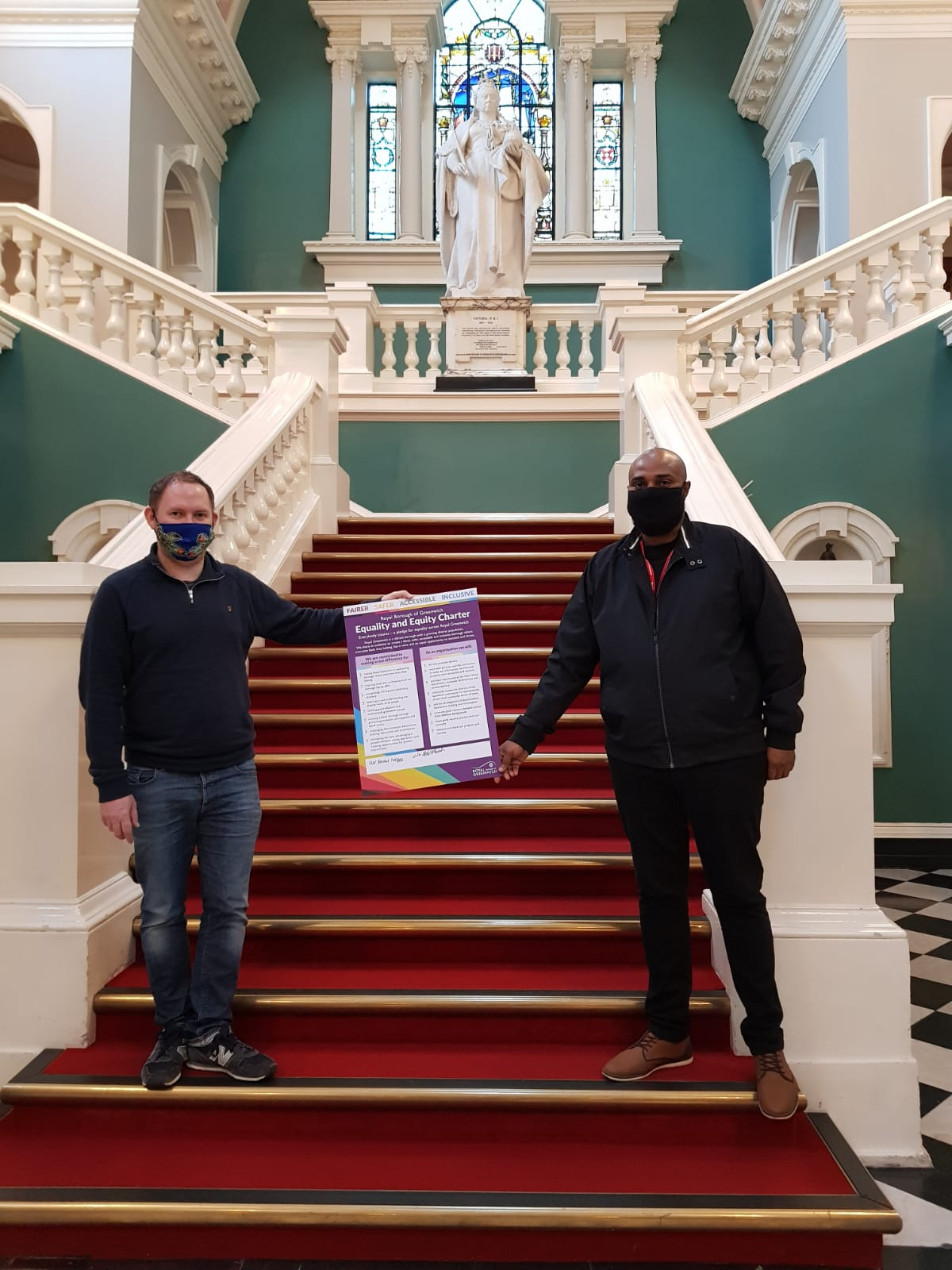 Cllr Danny Thorpe and Cllr Adel Khaireh, launch the borough's first Equality and Equity Charter - on stairs of Town Hall holding up the Charter.