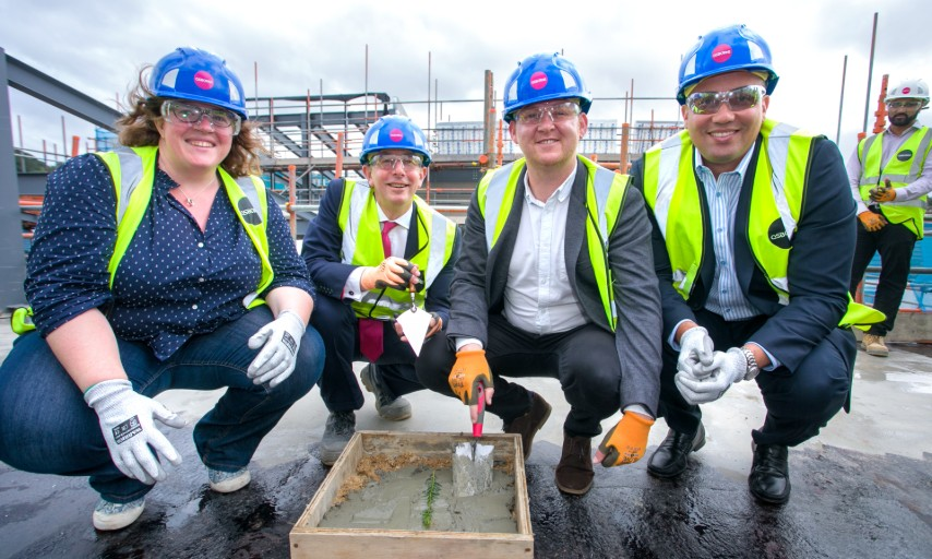 Plumstead Library topping out leader with cabinet members and andrew osborne
