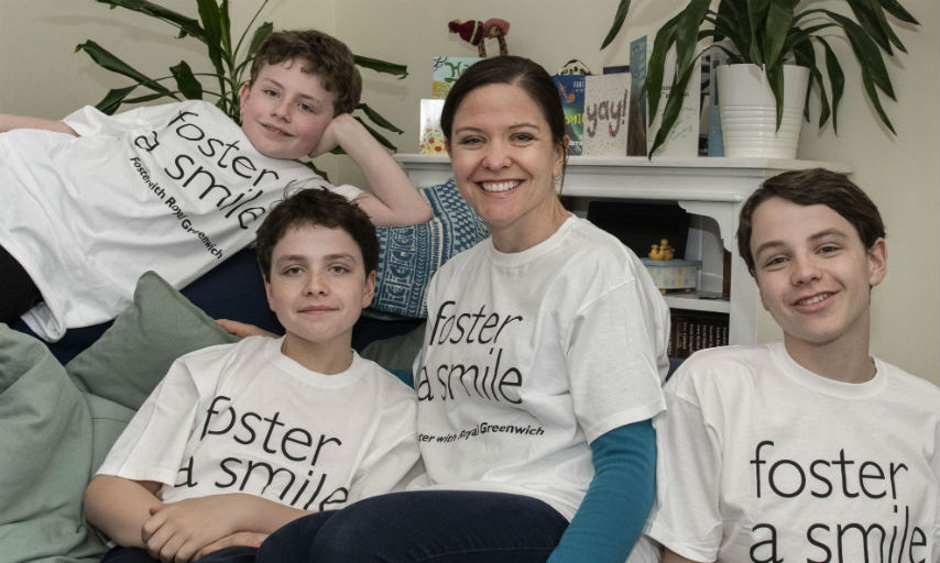 Royal Greenwich Foster Carer Livy Gibbs sitting with her sons in her living room.