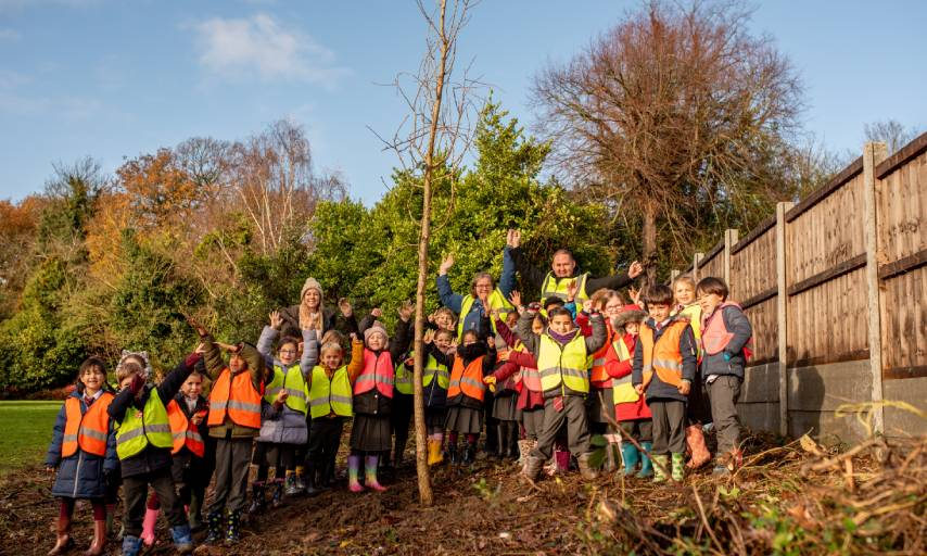 Leader Danny Thorpe, Councillor Miranda Williams and children from Christ Church Primary School planting the 1000th tree
