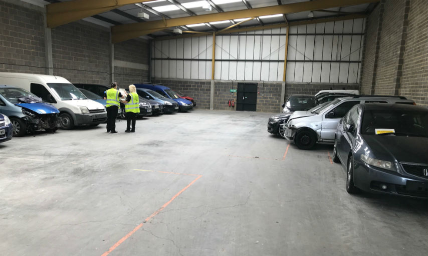 The 18 seized vehicles in a storage warehouse.