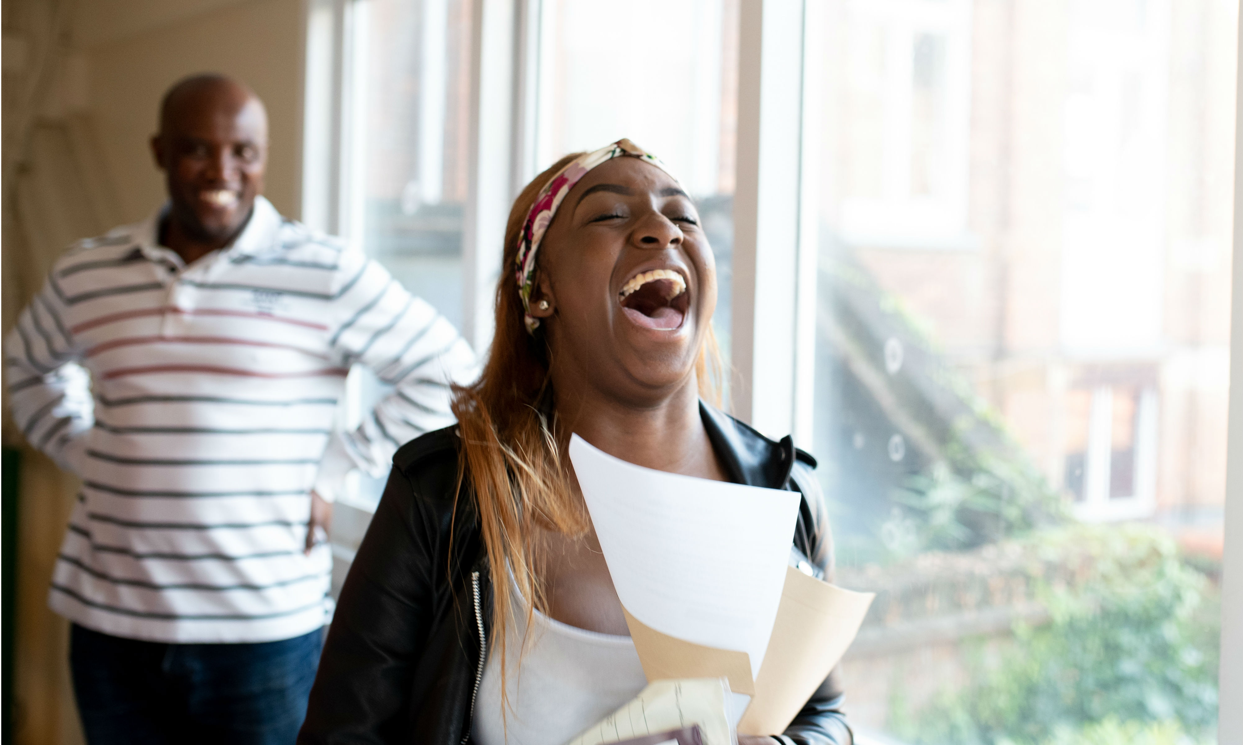 Girl overjoyed with her GCSE results.