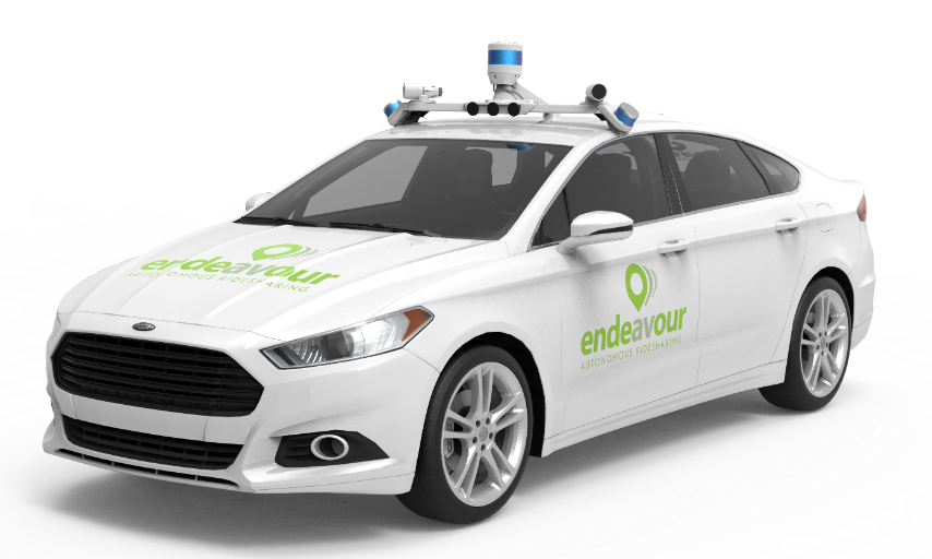 Picture of the white Endeavour autonomous ride-sharing service vehicle. The vehicle has a green Endeavour logo on the front and side of the car.