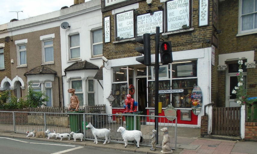 Items like full length mirrors, large animal sculptures and superhero figurines on display outside the Mirror Shop on Woolwich Road
