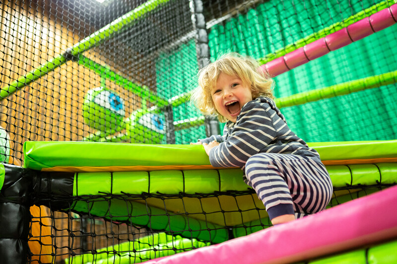 Child in soft play area